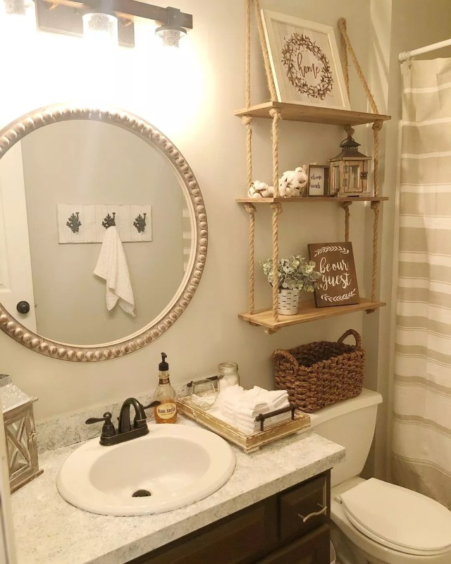 Bathroom with Hanging Shelves Above Toilet. Photo by Instagram user @interiors_by_danielle