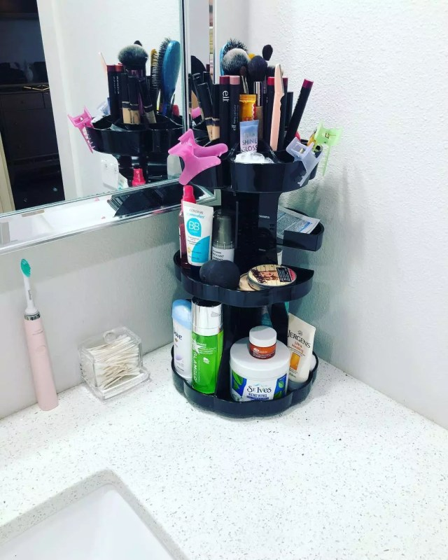 Three-tiered Storage Unit with Bathroom Supplies. Photo by Instagram user @amyday12