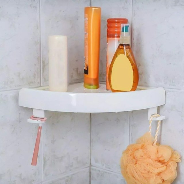 Corner Shelf in Shower with Shampoo and Razor. Photo by Instagram user @organizemeusa