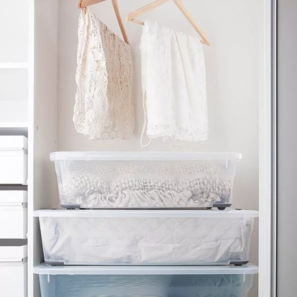 Clear Containers Storing Sheets and Blankets. Photo by Instagram user @ezystorage