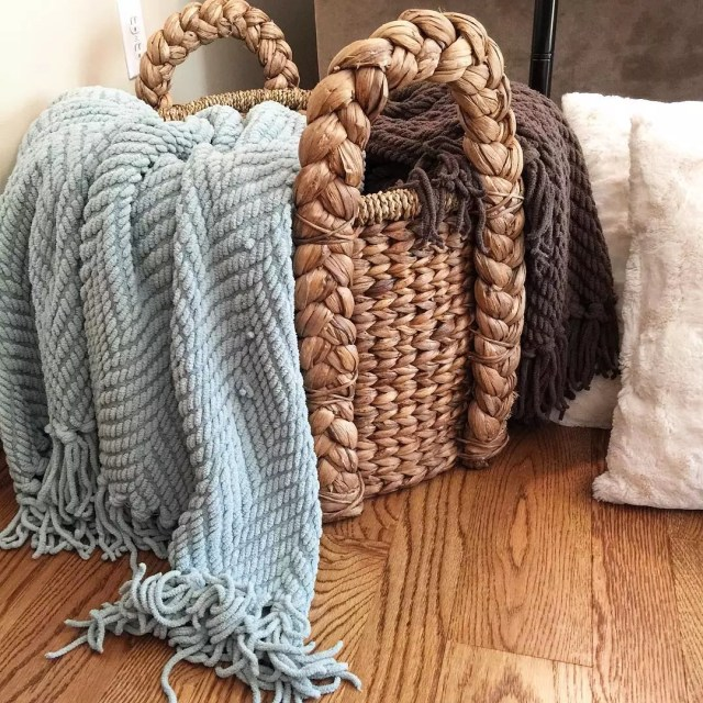 Blankets Stored in Wicker Basket. Photo by Instagram user @elleson513