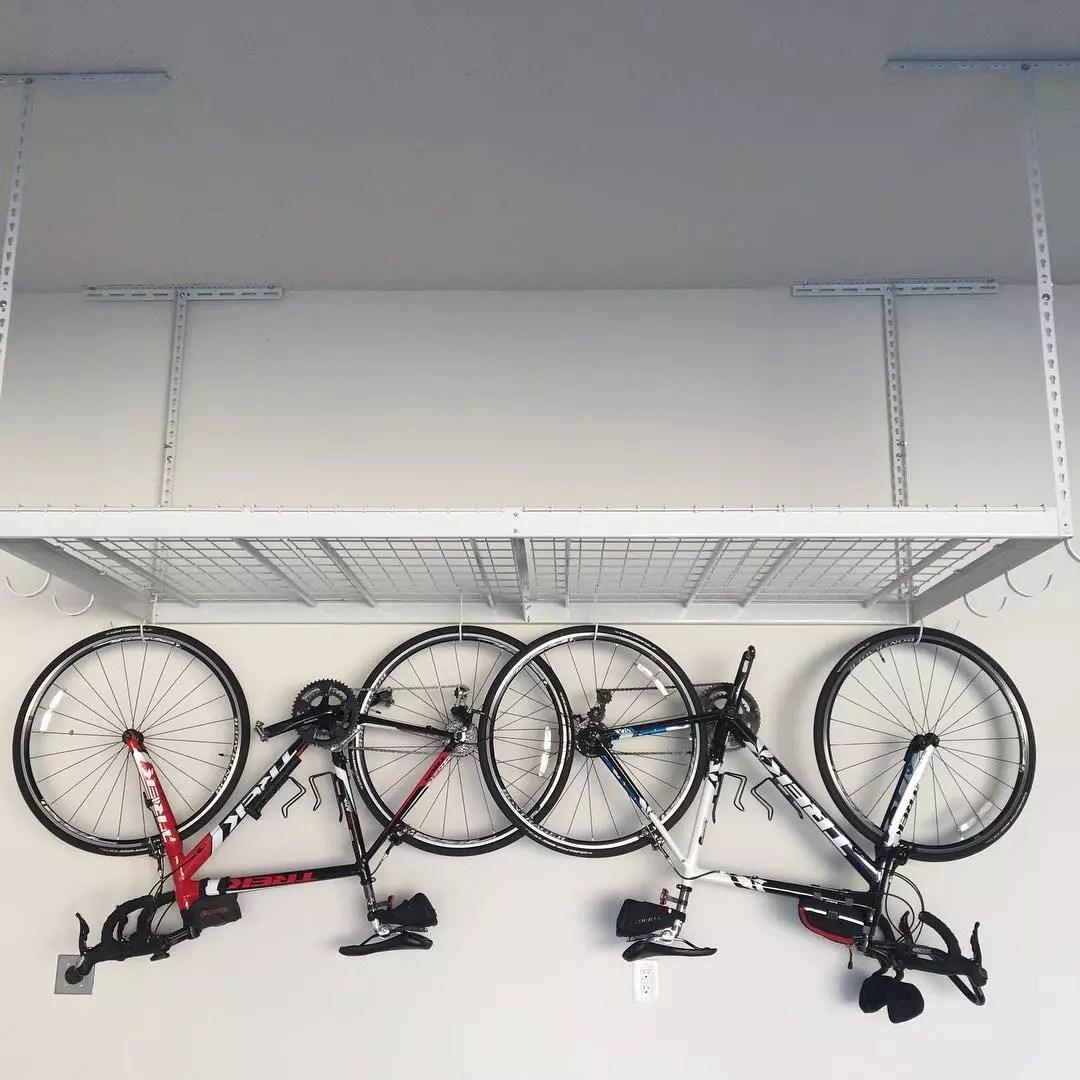 Bikes Hung From Storage Racks in Garage. Photo by Instagram user @lbagley1