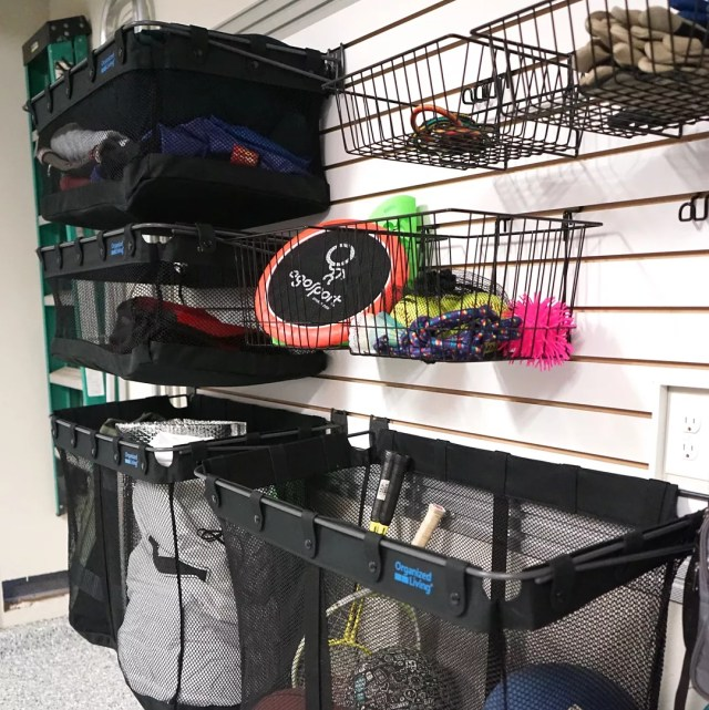 Sports Equipment Stored in Baskets and Bins on Garage Wall. Photo by Instagram user @kuzakscloset