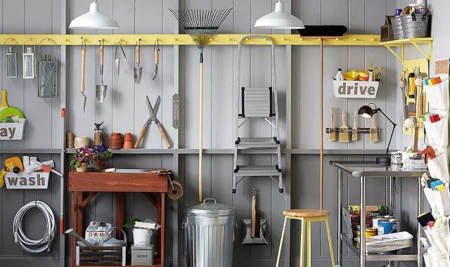 Garden Tools Hanging from Coat Racks in Garage. Photo by Instagram user @vintageestatehomes