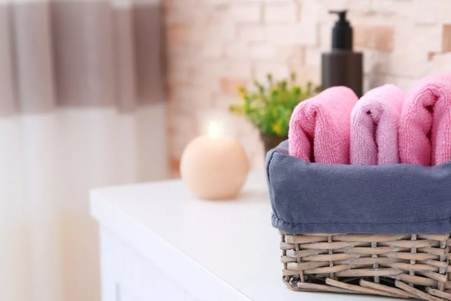 Towels in wicker basket in bathroom