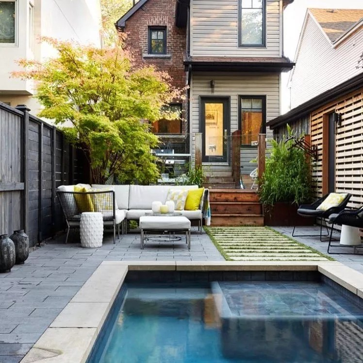 small backyard space with paved area, couch, and small pool photo by Instagram user @johnbaranellodesign