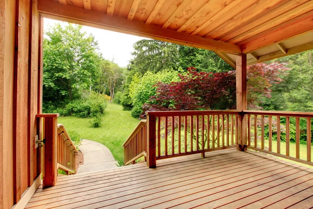 Covered wooden deck in backyard