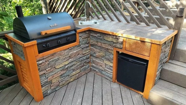 outdoor grilling area built with wooden countertops photo via @barrondesigns