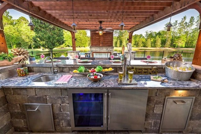 outdoor kitchen bar area with cool and fridge and beer tap photo by Instagram user @prattguys