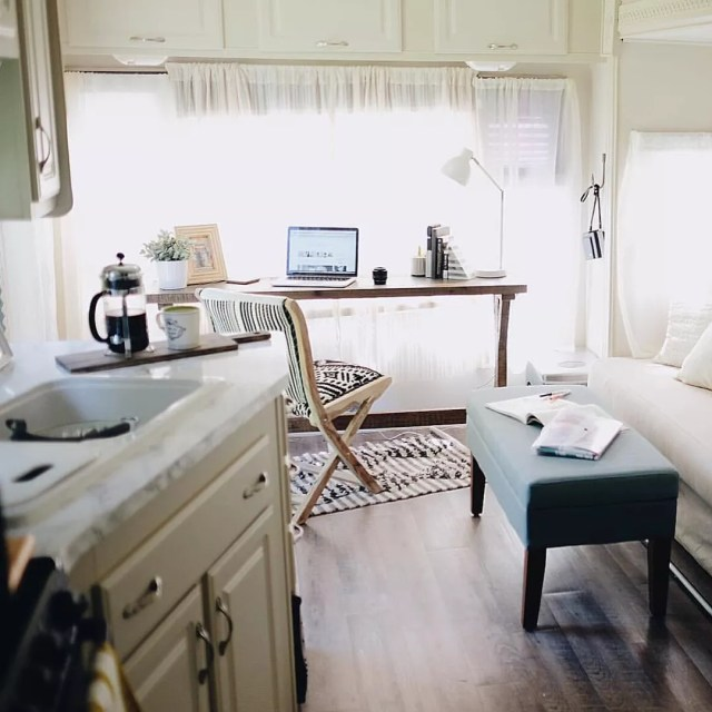 Work Station with Desk and Laptop Set Up Inside an RV. Photo by Instagram user @tinyflip