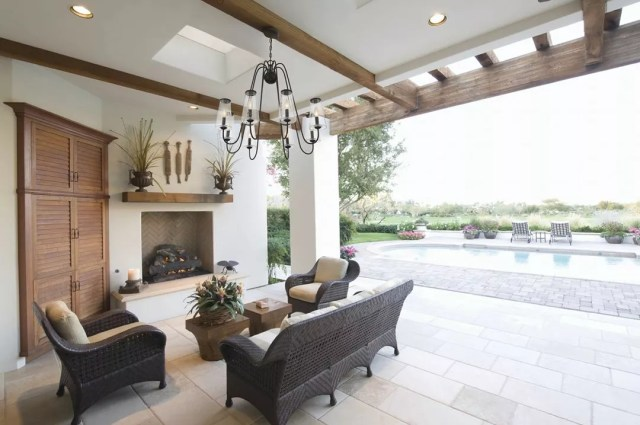outdoor patio with pool in the background and chandelier hanging from ceiling photo by Instagram user @lightsonline