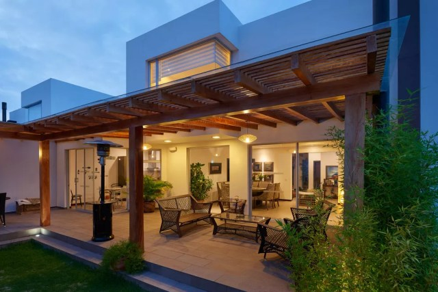 Do Outdoor Living Spaces Add Resale Value to Your Home ... on Extended Covered Patio Ideas id=73153