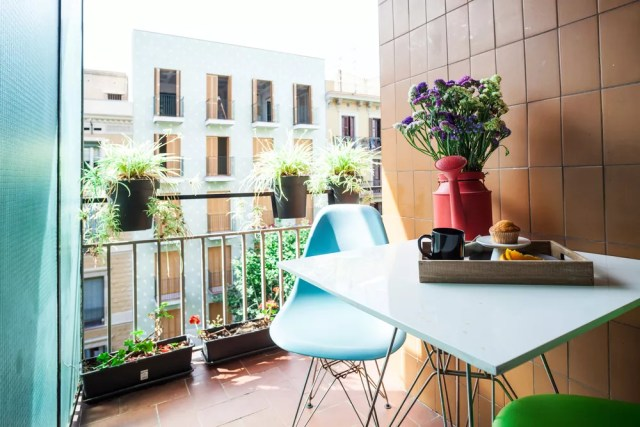 Apartment balcony with small table and chair