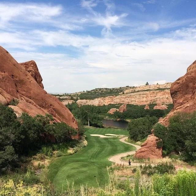 Looking down a golf course green placed between two red rock mountains Photo by Instagram user @va_av8r