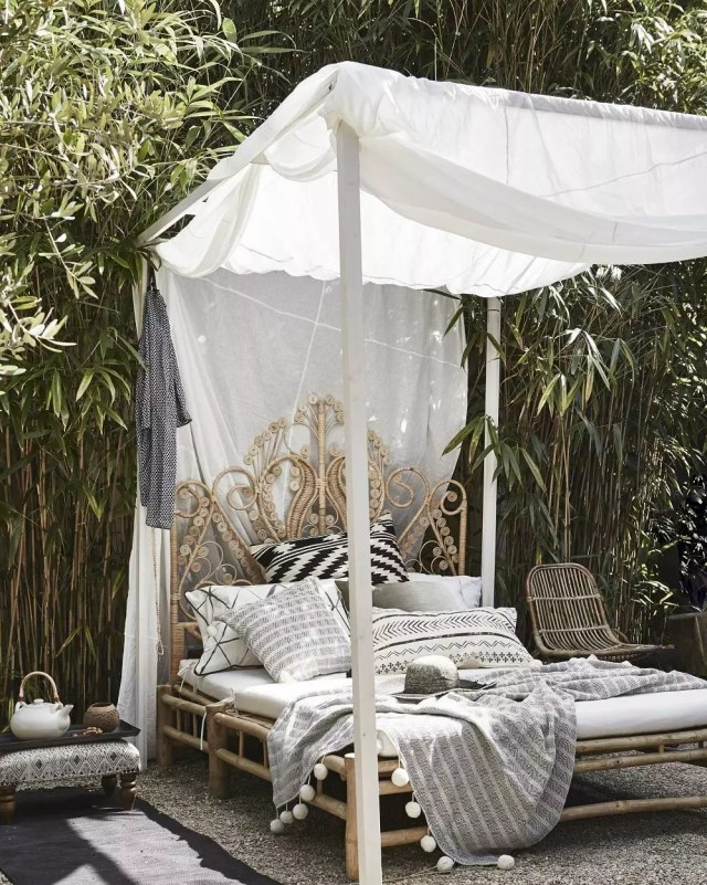 bali bed design with curtain overhead set up outdoors in backyard photo by Instagram user @pr_archidesign
