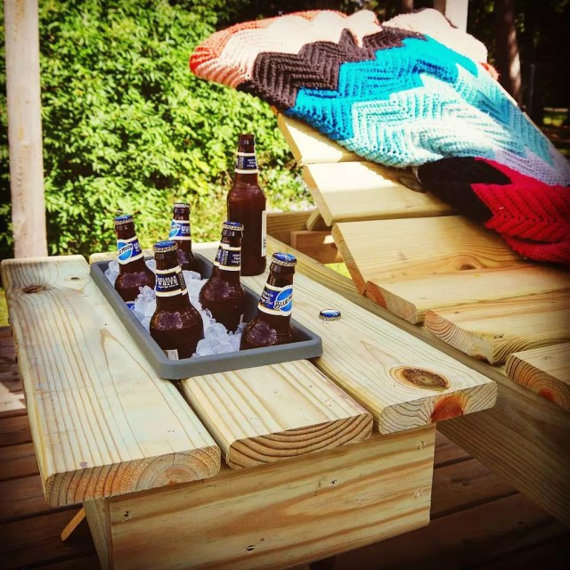 small handmade cooler table with ice and beer in it photo by Instagram user @grandmashousediy