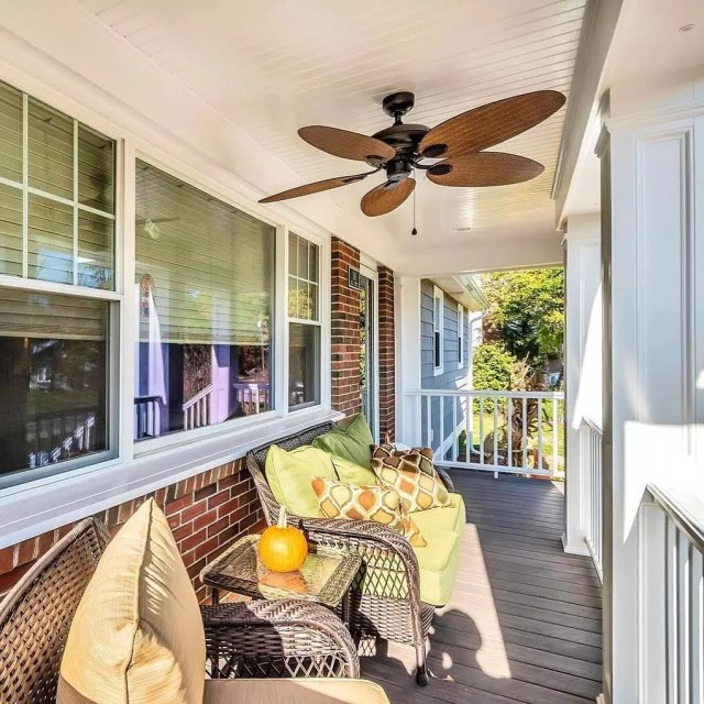 outdoor patio with furniture underneath an outdoor fan photo by Instagram user @kadilakhomes