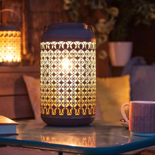 small lantern sitting on an outdoor table photo by Instagram user @lahaciendagb