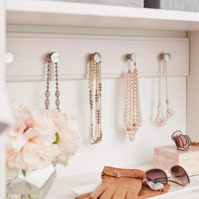 Necklaces and Pendants Hanging from Closet Hooks. Photo by Instagram user @inspiredclosets