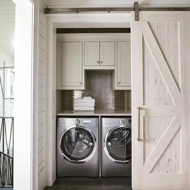 Stylish Wood Sliding Door to Laundry Room. Photo by Instagram user @glitterlaine