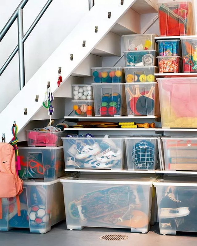 storage bins on shelves with small hangers going up the stairs photo by Instagram user @whatgoezwhere