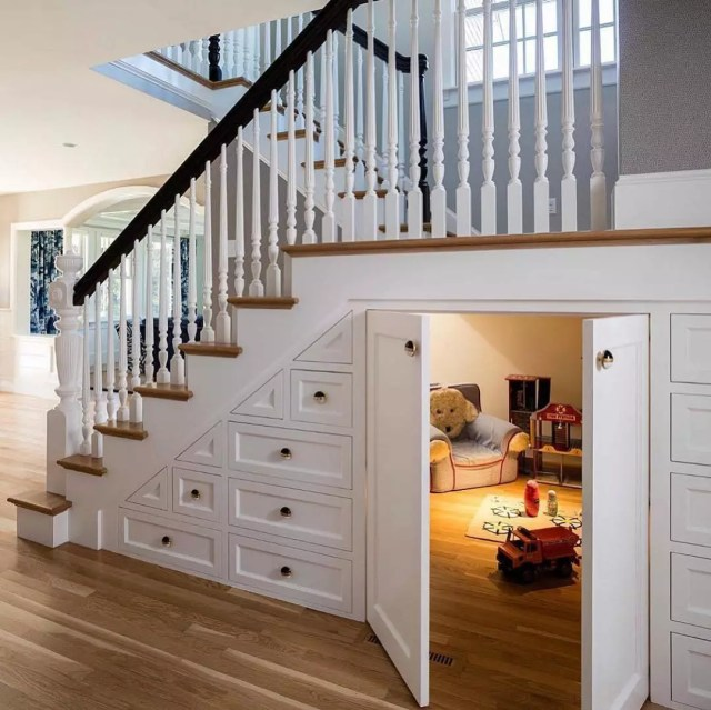 hidden play area for kids with a small chair underneath the stairs photo by Instagram user @motivo.design