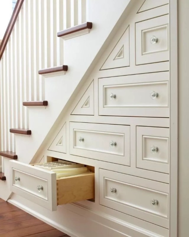 small drawers installed beneath the stairs with linens held in each photo by Instagram user @lorenzowilsonrealtor
