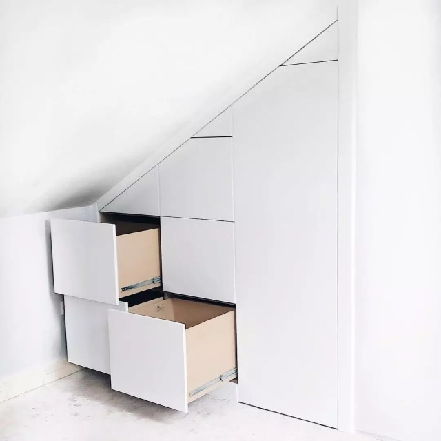 Smart storage drawers in angled wall. Photo by Instagram user @clever_closet