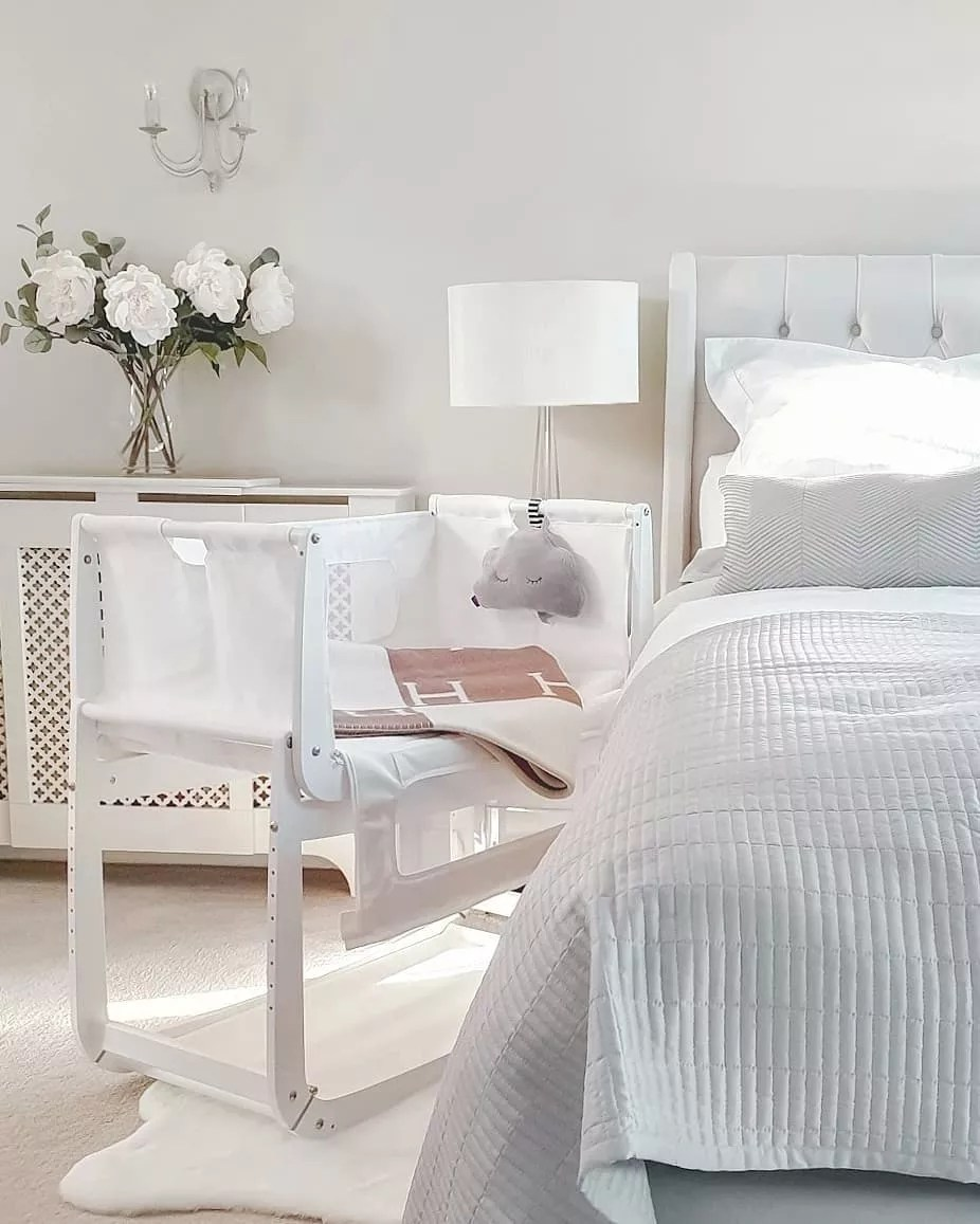 White contemporary master bedroom with baby bassinet. Photo by Instagram user @luxmumma