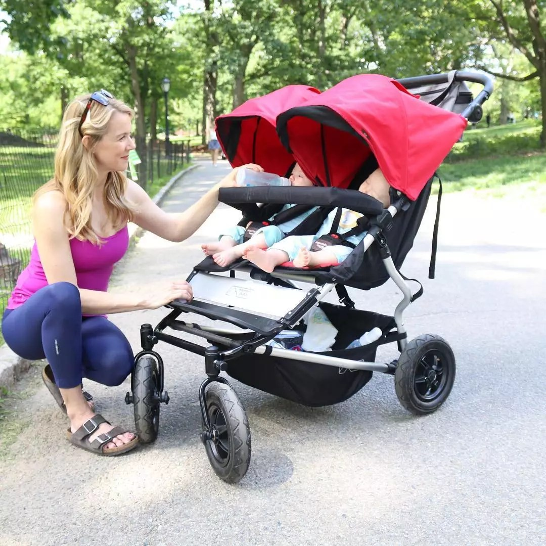 Woman Bottle-Feeding One of Her Two Babies Sitting Inside a Stroller in Central Park. Photo by Instagram user @kristinmcgee