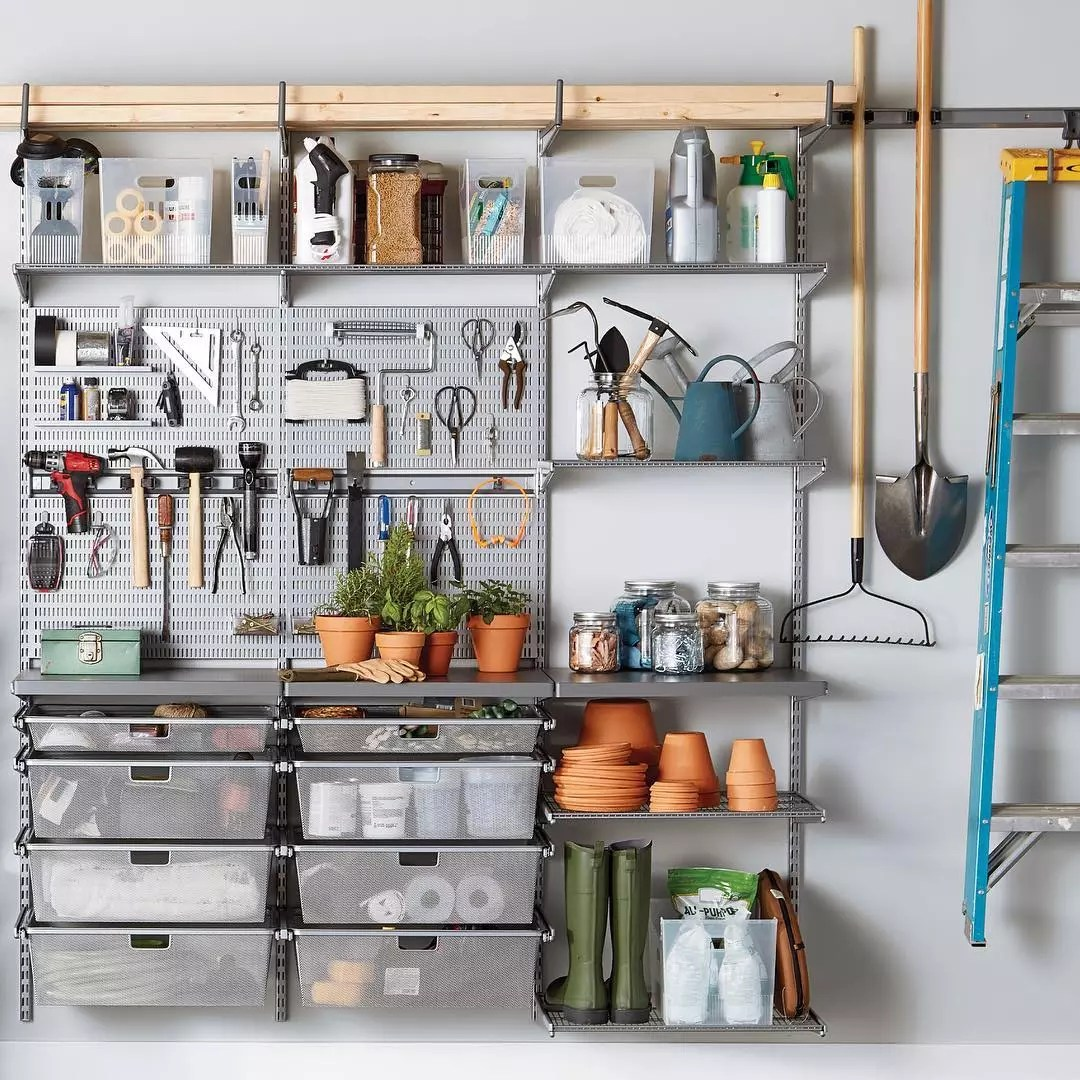 adjustable shelving in a shed for hanging tools photo by Instagram user @thecontainerstore