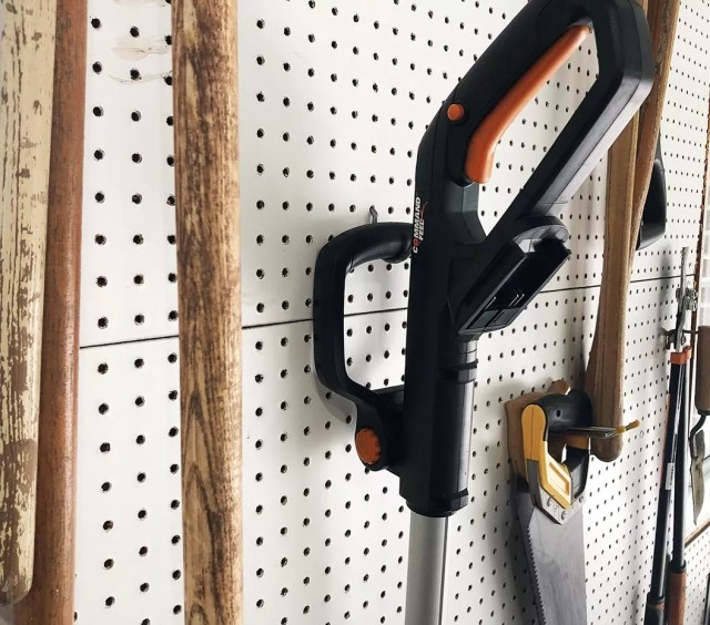gardening tools hung on hooks attached to peg board photo by Instagram user @greydock