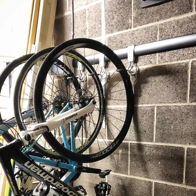bikes being hung on strong hooks in shed photo by Instagram user @thebikehanger
