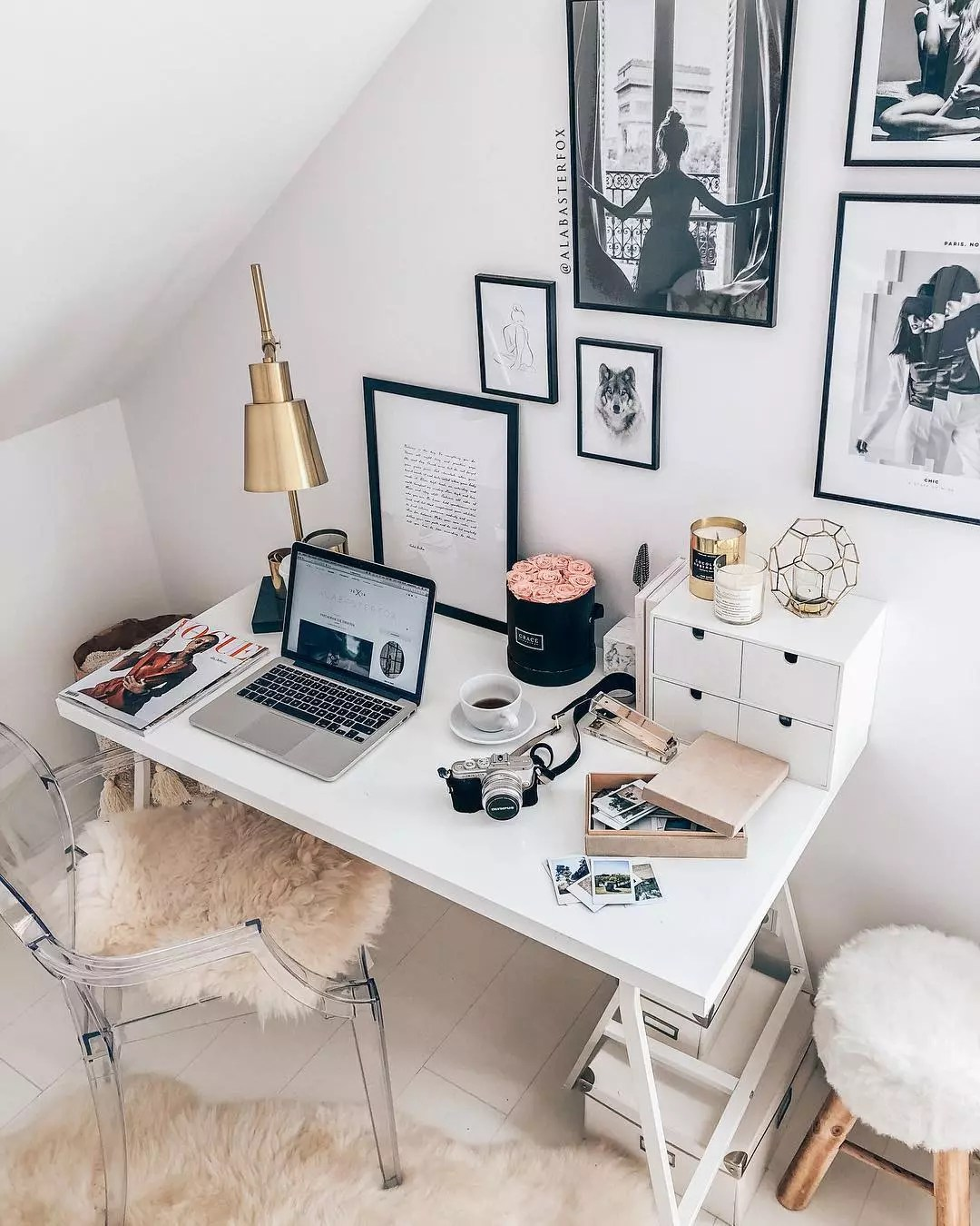 small white desk and clear chair with gold lamp on the desk in tiny room photo by Instagram user @alabasterfox