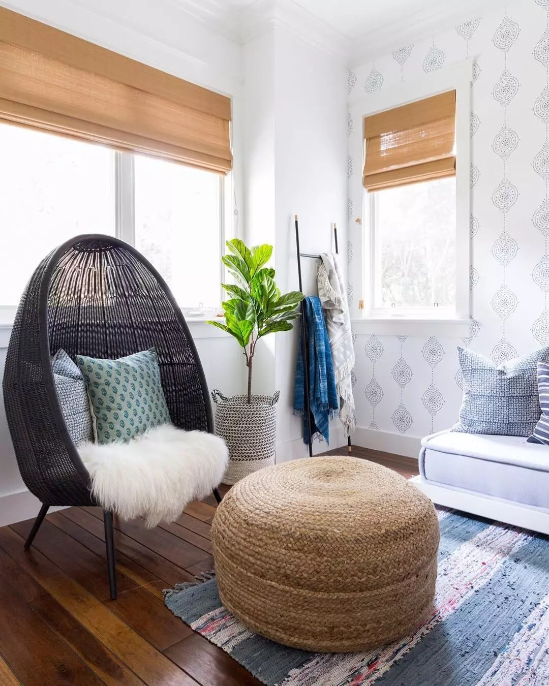 small hangout room with egg shaped chair and small ottoman with lots of natural light photo by Instagram user @lindseybrookedesign