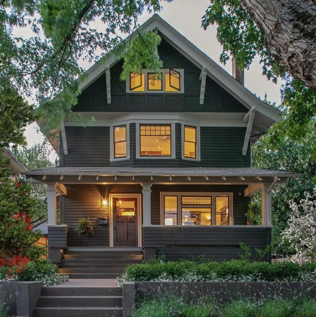 Craftsman-style house at twilight. Photo by Instagram user @bungalowsandcottages