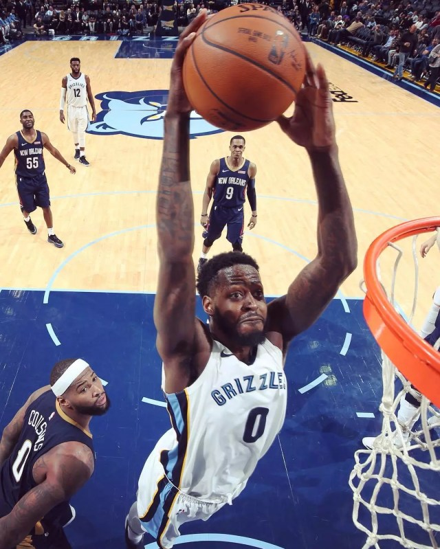 Jamychal Green jumps and dunks basketball in hoop at Grizzlies game vs New Orleans. Photo by Instagram user @memgrizz