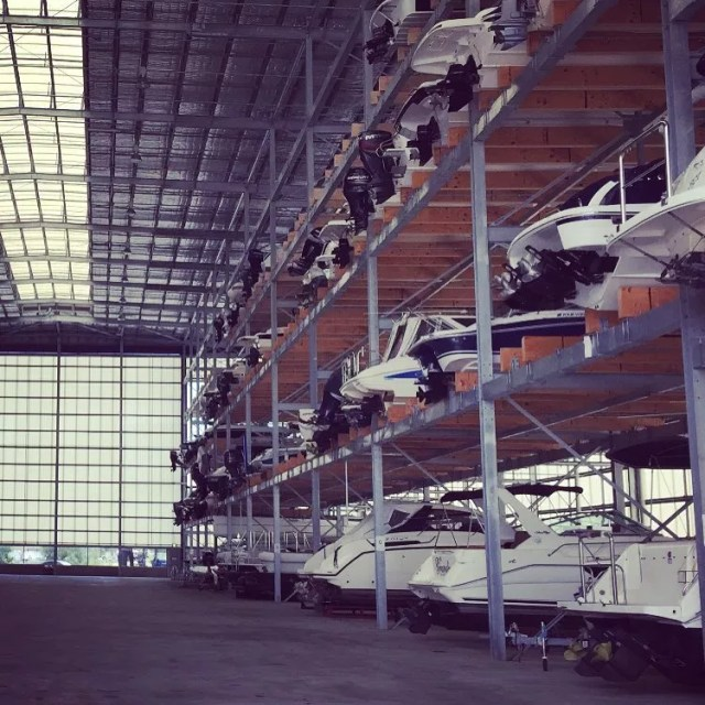 boats stacked inside of a dry storage hangar photo by Instagram user @sydneyboathouse