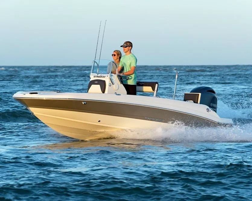 younger people standing and driving a center console boat on water photo by Instagram user @stingrayboats