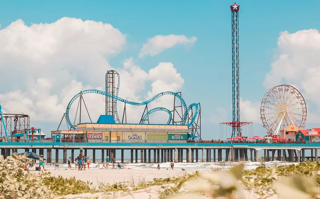 Roller Coasters and Amusement Rides at Pleasure Pier off Galveston Island. Photo by Instagram user @emibeaphotography
