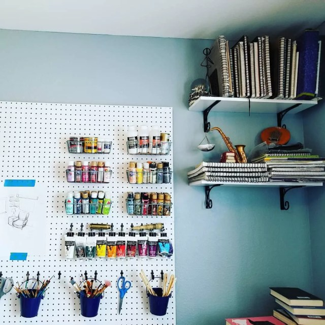 vertical storage used for more space in an art room at home photo by Instagram user @thewildship