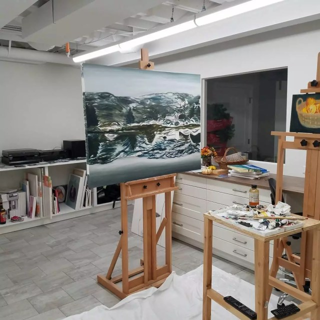 basement art studio with storage and easel in middle of the room photo by Instagram user @mauricegaan