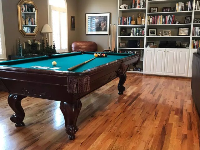 Game room with pool table and white shelves. Photo by Instagram user @pooltablesgvl