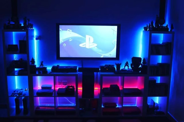 Game systems with blue lights behind shelves. Photo by Instagram user @t_bargah