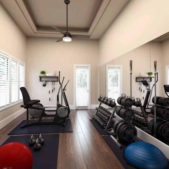 Home fitness room with bike and weights. Photo by Instagram user @queen2bee68
