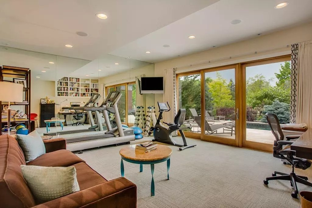 Home office with stationary bike and treadmills. Photo by Instagram user @chanindevelopment
