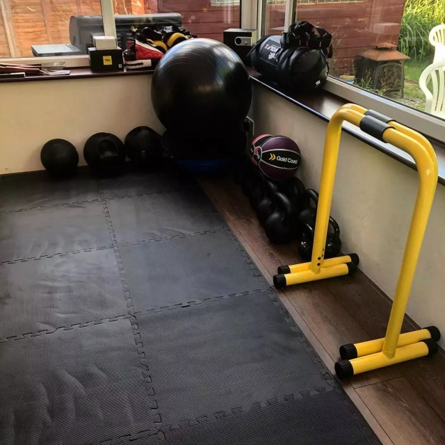 Rubber floor mats used in home fitness center. Photo by Instagram user @strive4healthandfitness