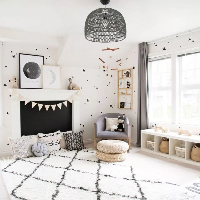 Black and white polka dot room with fuzzy carpet. Photo by Instagram user @winterdaisykids