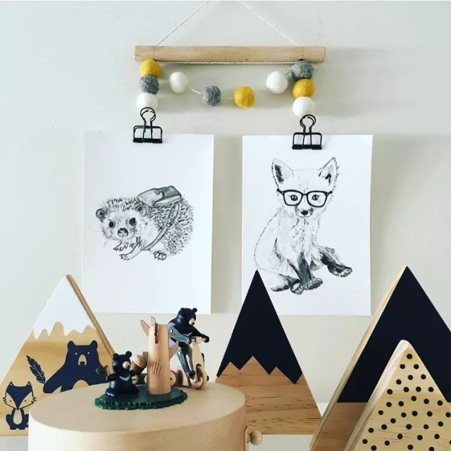 Drawing of a hedgehog and fox hanging on wall. Photo by Instagram use @nurseryroom