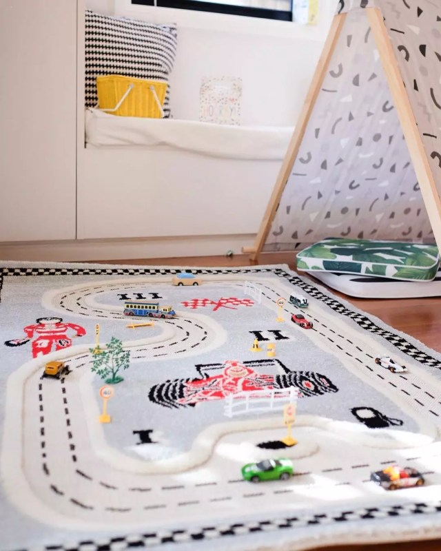 Kids rug with race tracks on it. Photo by Instagram user @urbanbabyshop